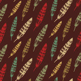 Vector colorful seamless feather pattern in sketch style. Hand drawing plumage endless texture. Vector colorful seamless feather pattern in sketch style. Hand Stock Photos