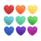 Fluffy pom-poms in the shape of a heart Royalty Free Stock Images