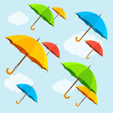 Vector colorful umbrellas fly with clouds. Flat Royalty Free Stock Photography