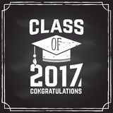 Vector Congratulations graduates Class of 2017 badge. Concept for shirt, print, seal, overlay or stamp, greeting, invitation card. Design with graduation cap Stock Photography