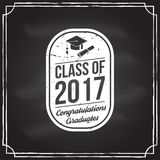 Vector Congratulations graduates Class of 2017 badge. Concept for shirt, print, seal, overlay or stamp, greeting, invitation card. Design with graduation cap Royalty Free Stock Photography
