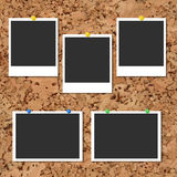 Vector cork board with photo cards and color pin. Vector cork board with five blank instant photo cards and color pins Royalty Free Stock Photography