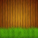 Vector creative grass on wooden background Stock Photography