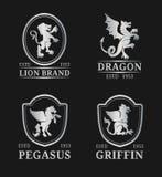 Vector crest monogram templates. Luxury pegasus,dragon, lion,griffin design. Graceful animals silhouettes illustrations. Royalty Free Stock Photos