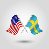 Vector crossed american and swedish flags on silver sticks - symbol of united states of america and sweden Royalty Free Stock Images