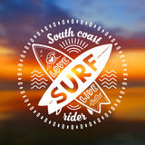 Vector crossing surfing boards stamp with hand drawn sign Love, Live, SURF on blurred sunset beach background Royalty Free Stock Photos