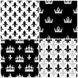 Vector crowns and fleur de lis seamless patterns set in black Royalty Free Stock Photography