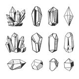 Vector crystals and minerals, black and white illustration. Set of hand drawn vector crystals and minerals. Gems and stones isolated on white background royalty free illustration