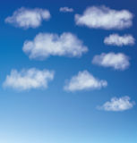 Vector cumulus clouds against a blue sky Royalty Free Stock Photo