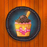 Vector cupcake with chocolate cream. Stock Image