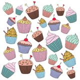Vector cupcake illustration. Set of hand drawn cupcakes. Doodle cakes with cream and berries Royalty Free Stock Images