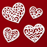 Vector cut out paper lacy hearts Stock Image
