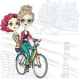Vector cute girls on the bike in Amsterdam Royalty Free Stock Images