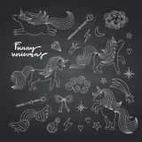 Vector cute hand drawn magic unicorns and stars set on black chalkboard royalty free illustration
