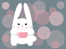 Vector Cute rabbit. The white rabbit drinking tea from a pink big cup. Smiling rabbit on a dots background. Rabbit, a symbol of 2011, according to the Chinese Stock Photography