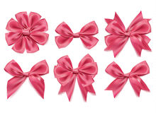 Vector 3d realistic ribbon shaped pink bows set. isolated background Stock Photos