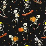 Vector dancing and skateboarding skeletons Haloween repeat pattern background. Great for spooky fun party themed fabric. Gifts, giftwrap. Textile pattern Royalty Free Stock Photo