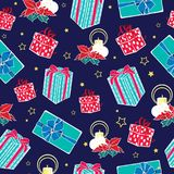 Vector dark blue Christmas gifts boxes and candles seamless repeat pattern background. Can be used for holiday giftwrap. Fabric, wallpaper, stationery Royalty Free Stock Image