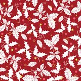 Vector dark red holly berry holiday seamless pattern background. Great for winter themed packaging, giftwrap, gifts. Projects. Surface pattern print design Royalty Free Stock Images