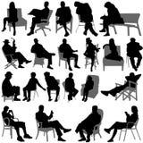 Vector de la gente que se sienta Foto de archivo libre de regalías