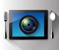 Vector de la lente de cámara en la tableta Imagenes de archivo