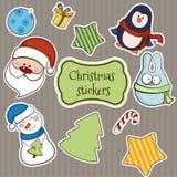 Vector de las etiquetas engomadas de la Navidad Imagenes de archivo
