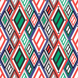 Vector decorative ornamental geometric background with asymmetrical rhombus in blue, red and green colors. Stock Photo