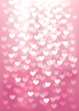 Vector Defocused lights in heart shape, pink color Stock Photos