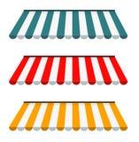 Sistema colorido de toldos rayados Imagen de archivo