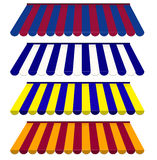 Sistema colorido de toldos rayados Fotos de archivo libres de regalías