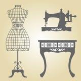 Vector del maniquí del vintage y de la máquina de coser Imágenes de archivo libres de regalías