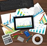 Vector desk with financial and statistical documents, keyboard, credit card, tablet. finance consultant, business. Analyst accounting workpalce. View from the Stock Photos