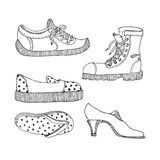 Vector different doodle shoes. Set of boot, slippers, espadrille, sandal and shoe Royalty Free Stock Image