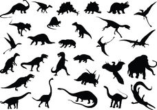 Vector dinosaurs. Vector silhouettes of dinosaurs and other prehistoric animals Stock Photos