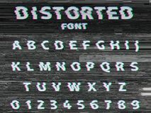 Vector distorted glitch font. Trendy style lettering typeface. White latin letters on gray glitched background Royalty Free Stock Photography