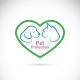 Vector of an dog and cat in the heart on white background. Pet Royalty Free Stock Images