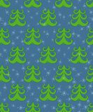 Vector doodle Christmas seamless background with fir tree and snowflakes.  Royalty Free Stock Image