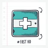Vector Doodle First Aid Icon. Vector doodle first aid kit icon illustration with color, drawn on lined note paper Stock Photo