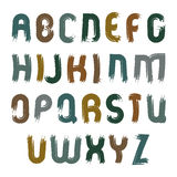 Vector doodle font with paint stains, handwritten watercolor cap Stock Photos