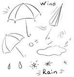 Vector doodle icons with umbrella, rain, hail, puddles. Decor elements Stock Images