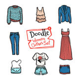 Vector doodle women clothes icons set. Hand drawn collection of fashion objects Stock Images