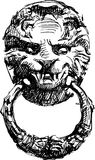 Door handle. Vector drawing of an ancient door handle in the form of a lions head stock illustration