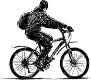 Boy on a bike. Vector drawing boy on a bicycle royalty free stock images