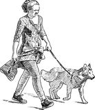 A city woman walks with her dog Royalty Free Stock Image