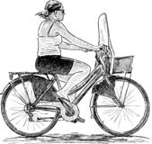 Sketch of a woman riding a bicycle stock illustration
