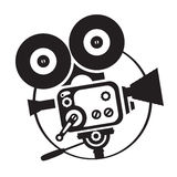 Vector drawing old fashioned movie camera. Vector black-white silhouette old fashioned movie camera Stock Photos