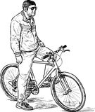 A city dweller with his bicycle Royalty Free Stock Image