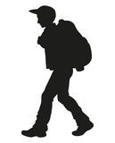 Vector drawing. Traveler with a backpack going up the path Royalty Free Stock Image
