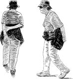 Sketch of the seniors women on a walk. Vector drawing of  the walking elderly women tourists Royalty Free Stock Images