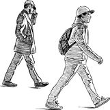Sketch of the casual urban pedestrians. Vector drawing of the walking townsmen Stock Photography
